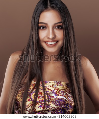 cute happy young indian woman in studio close up smiling, fashion mulatto smiling adorable - stock photo