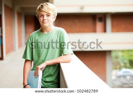 cute high school boy in school building - stock photo