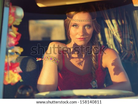 cute hippie girl in an old bus - stock photo