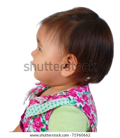 cute Hispanic baby girl looking up, profile view, isolated on white background - stock photo