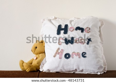 Cute housing and real estate concept with pillow and teddy - stock photo