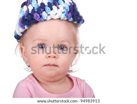 Cute image of a baby with a knit hat.