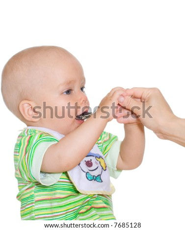 Cute independent eating child with spoon. Isolated over white - stock photo