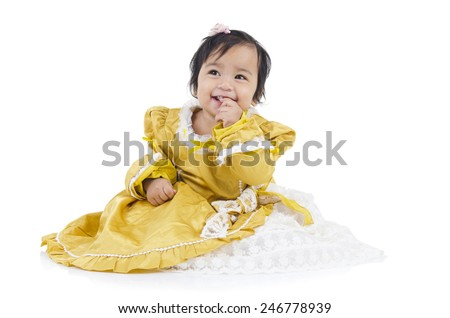 Cute indian baby eating biscuit - stock photo