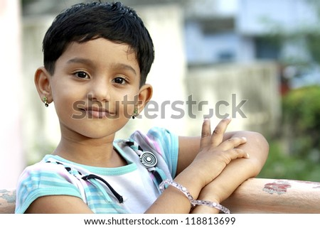 Cute Indian Girl Posing to the Camera - stock photo