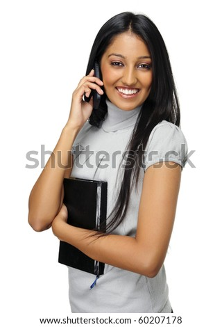 Cute Indian girl talks on her mobile phone - stock photo