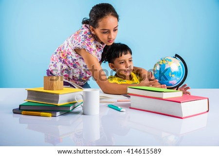 cute indian kids studying, smart asian girl and boy doing home work, indian siblings studying, indian small girl helping her brother in doing homework