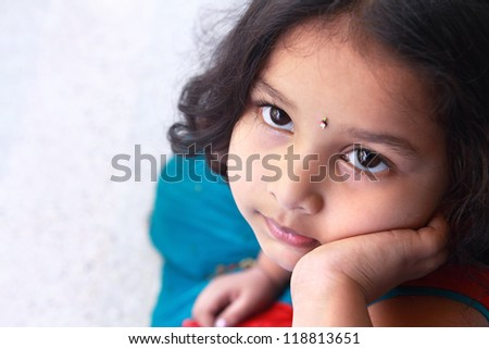 Cute Indian Little Girl Looking Up - stock photo