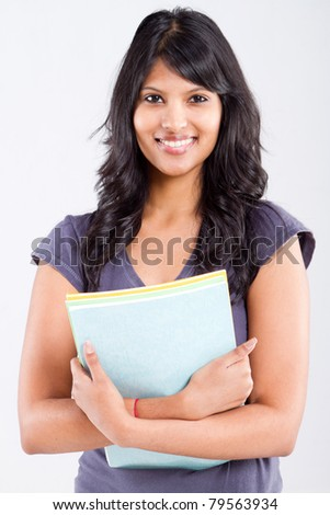 cute indian university student holding books - stock photo