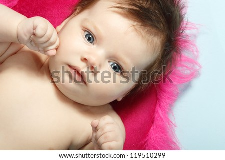 cute infant baby, beautiful kid's face and hands closeup, studio shot - stock photo