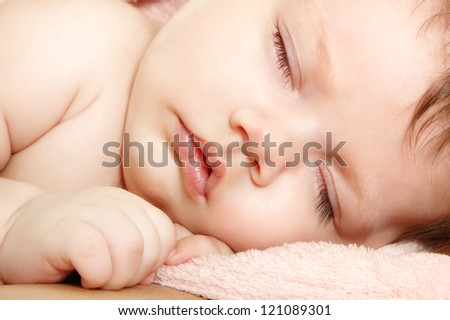 cute infant baby sleeping, beautiful kid's face closeup - stock photo