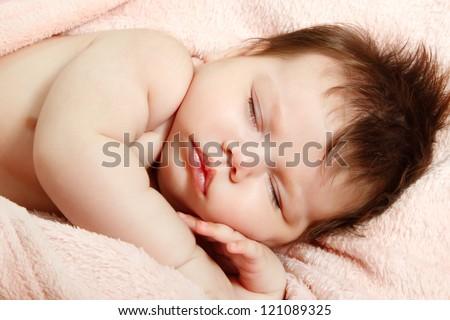 cute infant baby sleeping, beautiful kid's face closeup, studio shot - stock photo