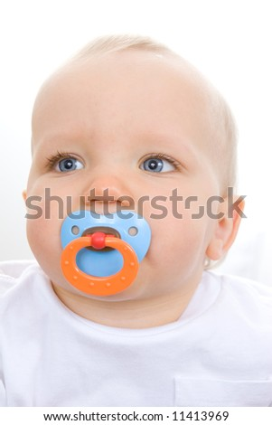 Cute infant with pacifier in mouth.  Focus on eyes.