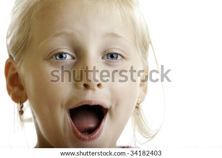 Cute innocent Child laughs into camera - stock photo