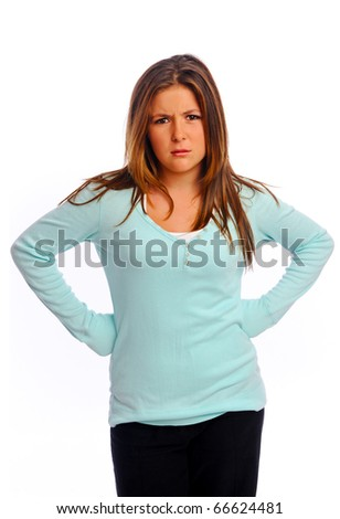 Cute isolated girl frowns in the studio - stock photo