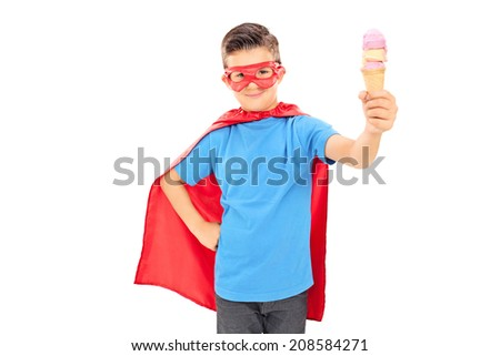 Cute junior in superhero costume holding an ice cream isolated on white background - stock photo