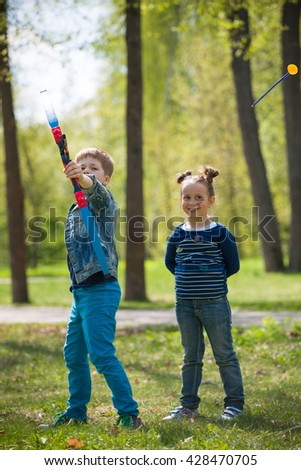 Cute kid boy archer with bow shooting in sunny summer day. little children shoot bow in the park. Outdoors. Sport activities with children. Sport and lifestyle concept. Aiming high - stock photo