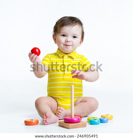 cute kid boy playing with colorful toy pyramid - stock photo