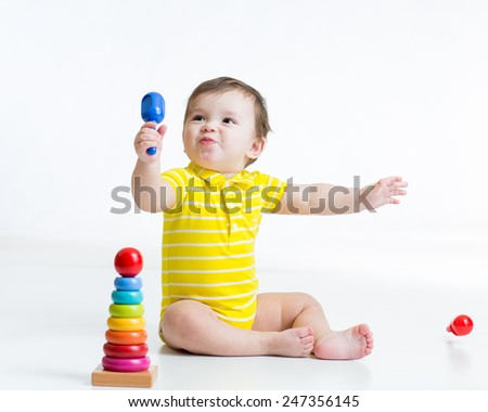 cute kid child boy playing with toys