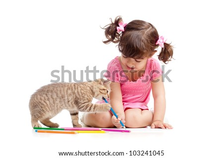 Cute kid drawing with pencils. Kitten next to girl.