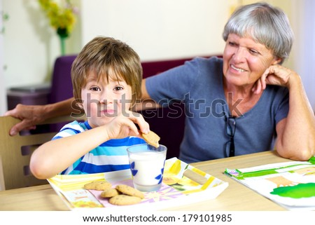 Cute kid eating biscuits happy smiling - stock photo