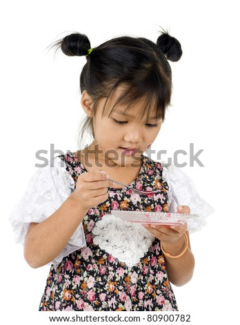 cute kid eating, isolated on white background - stock photo