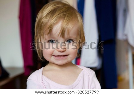 Cute kid girl at home smiling - stock photo