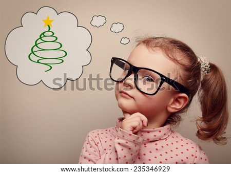 Cute kid girl in glasses thinking about gift on Christmas holiday. Vintage portrait - stock photo