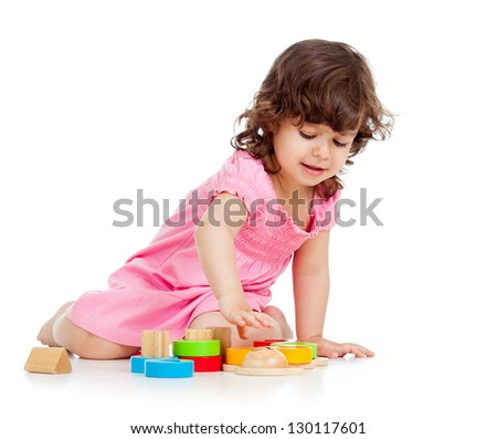 cute kid girl playing with colorful toys, isolated on white background
