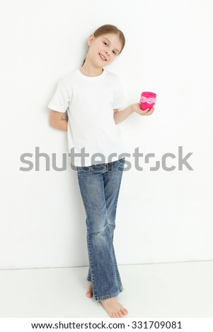 Cute kid holding molds for baking cookies - stock photo
