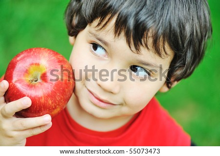 Cute kid holding red apple - stock photo