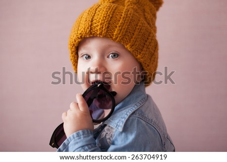 cute kid in knitted mustard color hat - stock photo