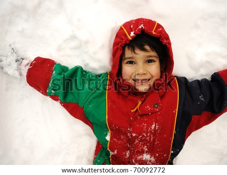 Cute kid in snow, snowtime, winter, happiness - stock photo