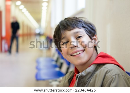 Cute kid inside the building - stock photo