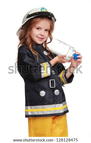 Cute kid is posing on camera in firefighter costume on Holiday