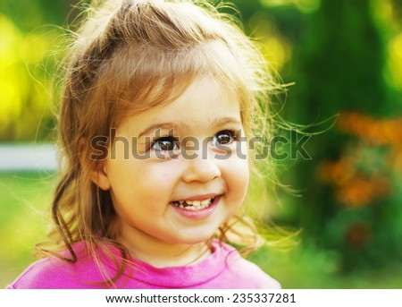 Cute kid is smiling in sunny day - stock photo