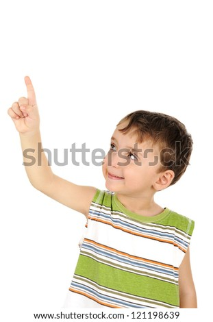 Cute kid looking and finger pointing isolated - stock photo