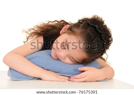 Cute kid lying on a green star-shaped pillow - stock photo