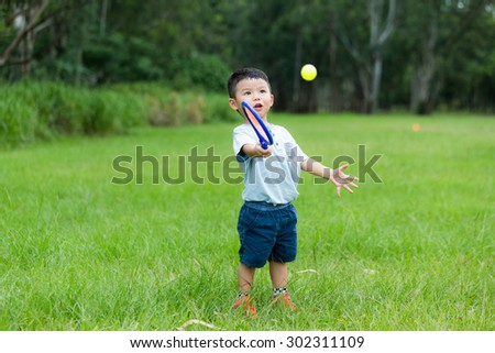 Cute kid play with tennis at outdoor - stock photo