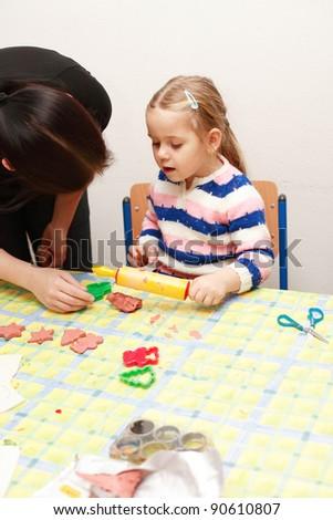 Cute kid playing in kindergarten - stock photo