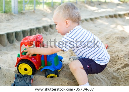 Cute kid playing in sandbox