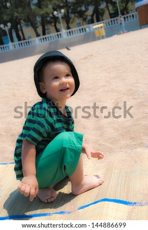 Cute kid playing on the beach, closeup