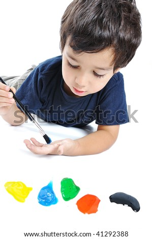 Cute kid playing with colors on white ground - stock photo