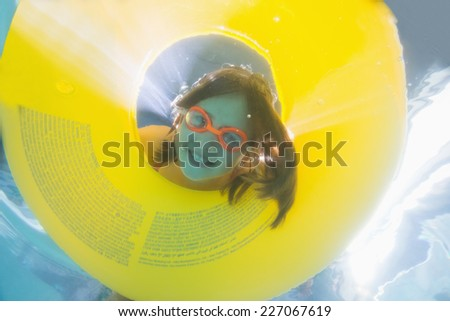 Cute kid posing underwater in pool at the leisure center - stock photo