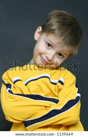 Cute kid shot in a studio setting - stock photo