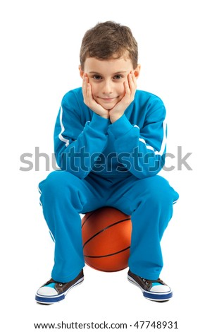 Cute kid sitting on a basket ball isolated on white - stock photo