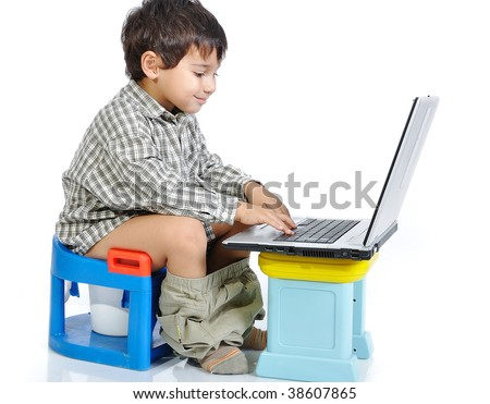 Cute kid sitting on toilet with laptop