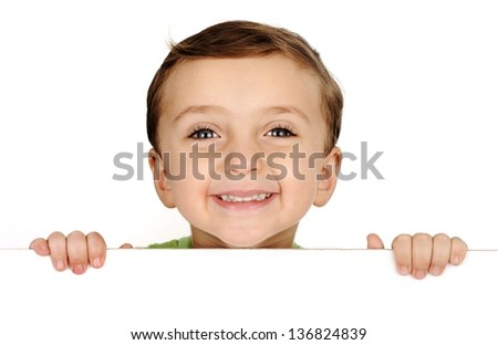 Cute kid smiling and holding a banner on white with copy space - stock photo