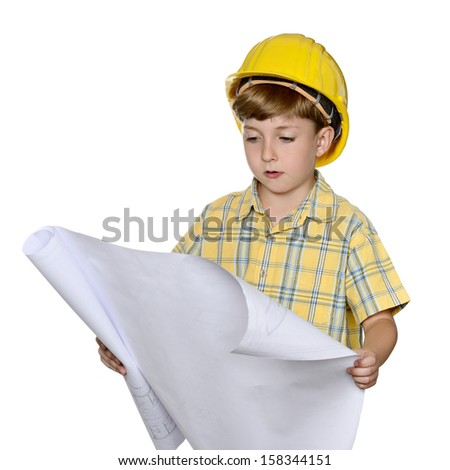 Cute kid while wearing construction helmet and holding plans, isolated on white background