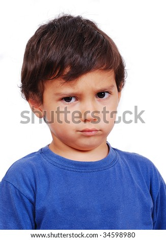 Cute kid with angry expression on his face